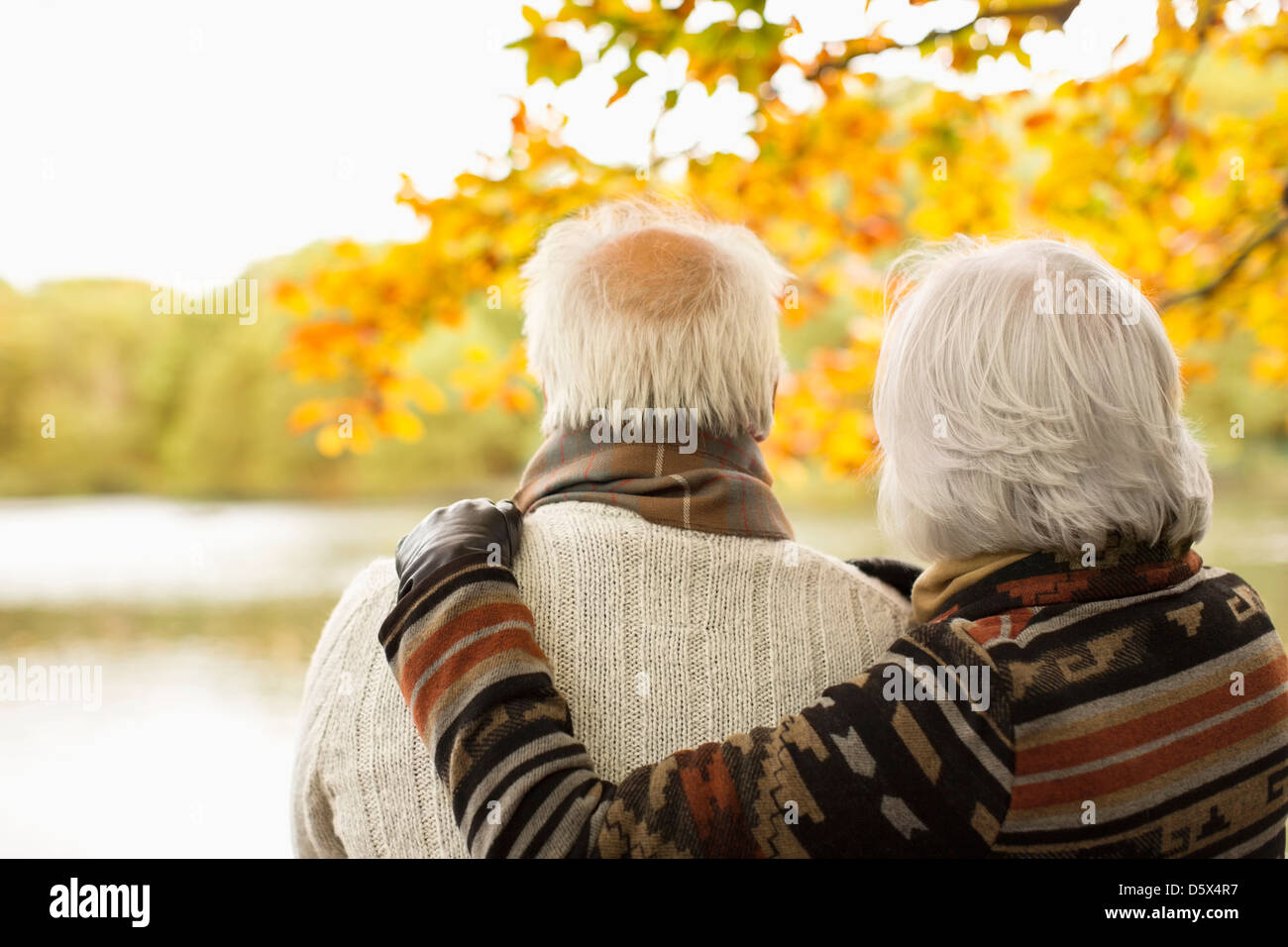 Older couple hugging in park Stock Photo