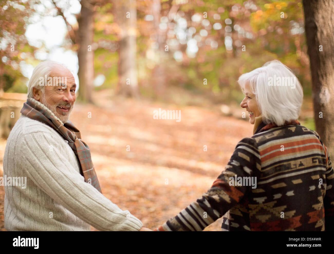 Older couple walking in park - Stock Image