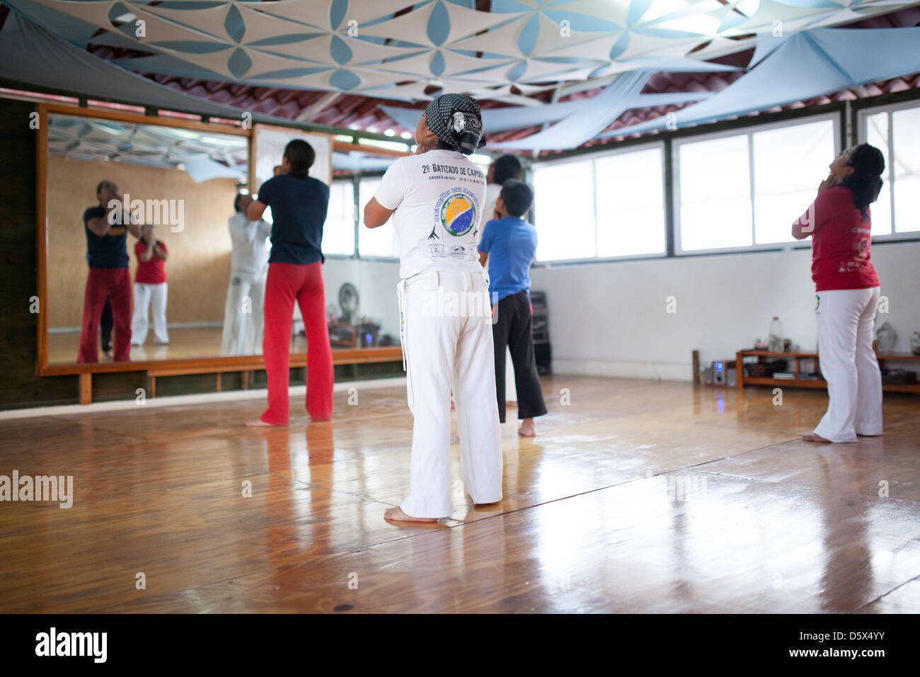 Students in a capoeira group warm up before starting their class. - Stock Image