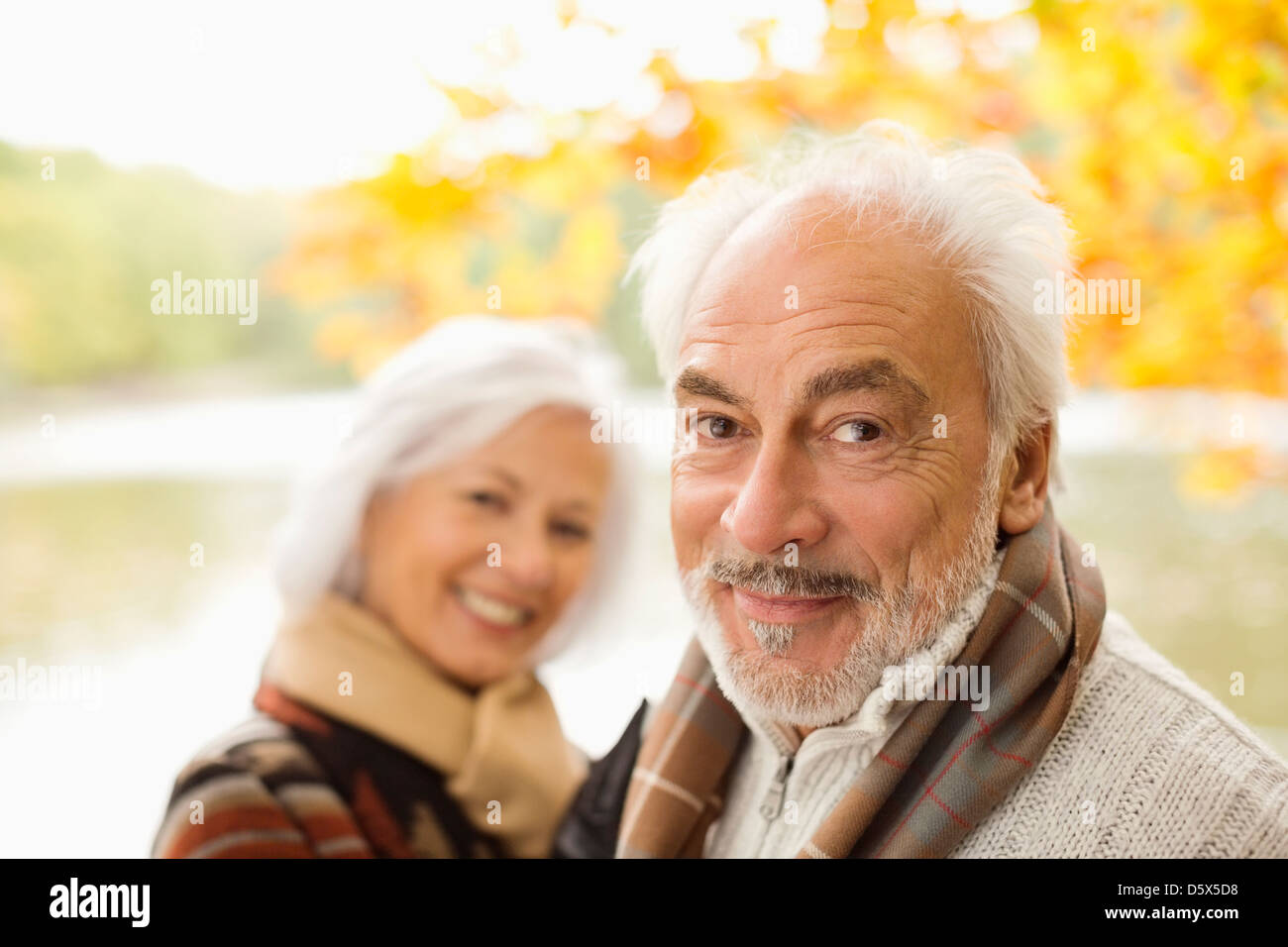 Older couple standing in park - Stock Image