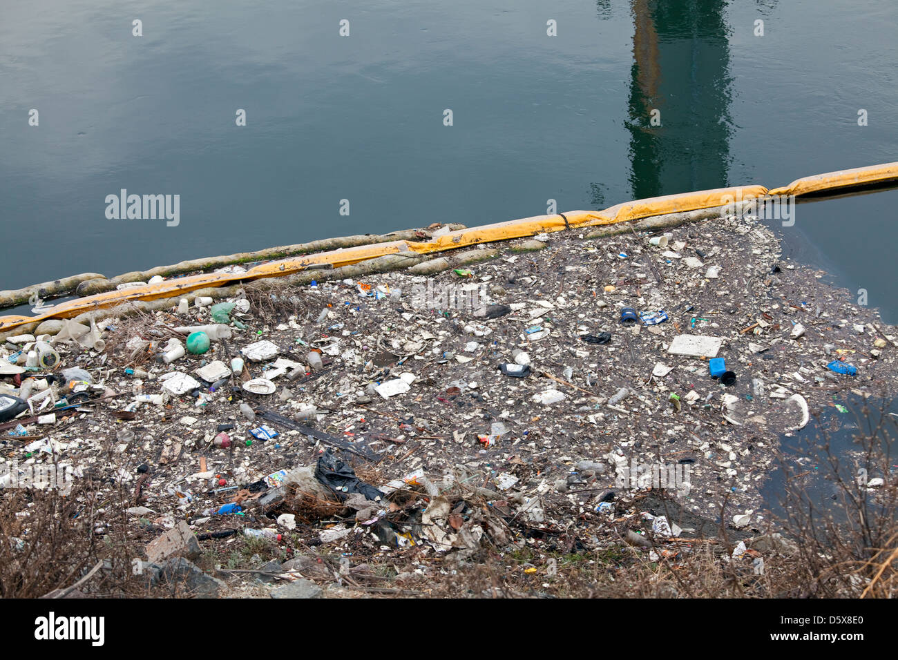 Boom collecting garbage and trash from urban runoff. Dominguez Channel, a 15.7 mile stream that drains the Dominguez - Stock Image