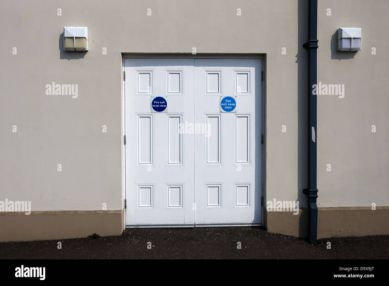 fire exit keep clear emergency doors in a public access building moira county down northern ireland uk - Stock Image