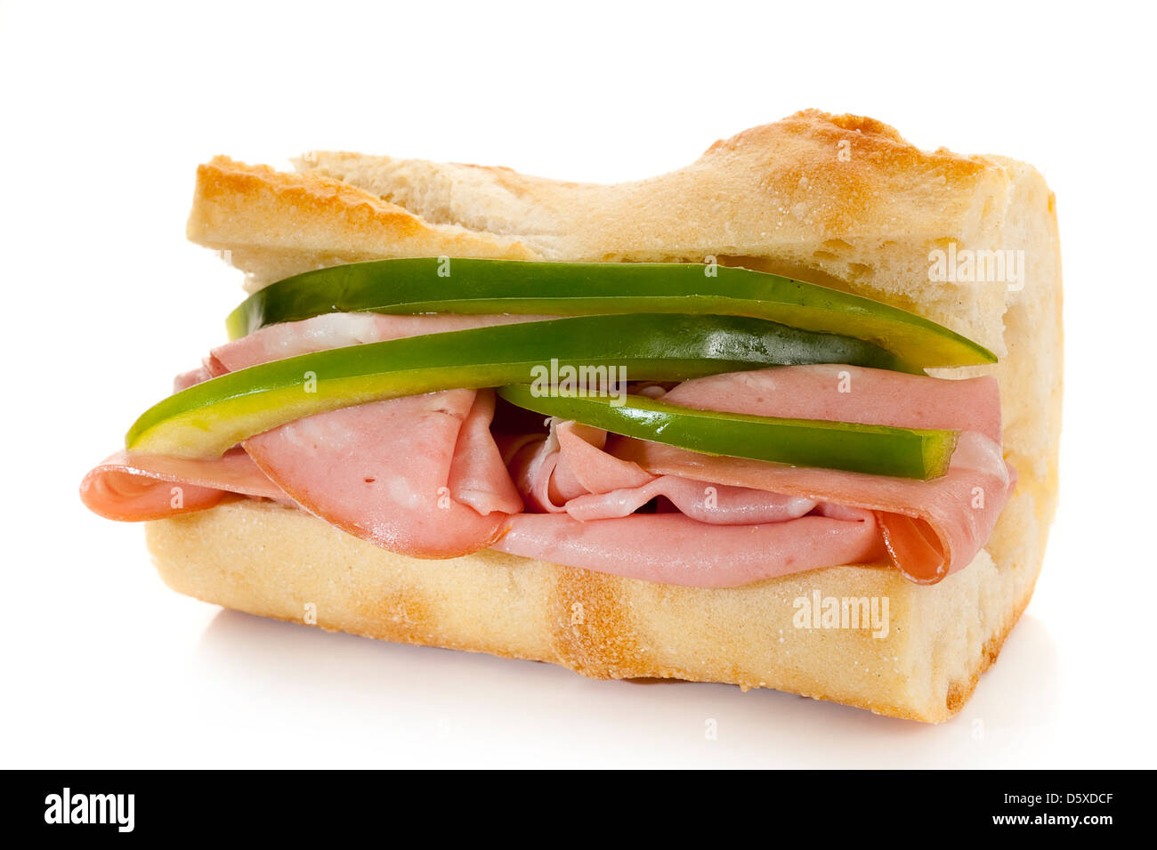 Close-up image of fresh made sandwich with peppers and salami - Stock Image