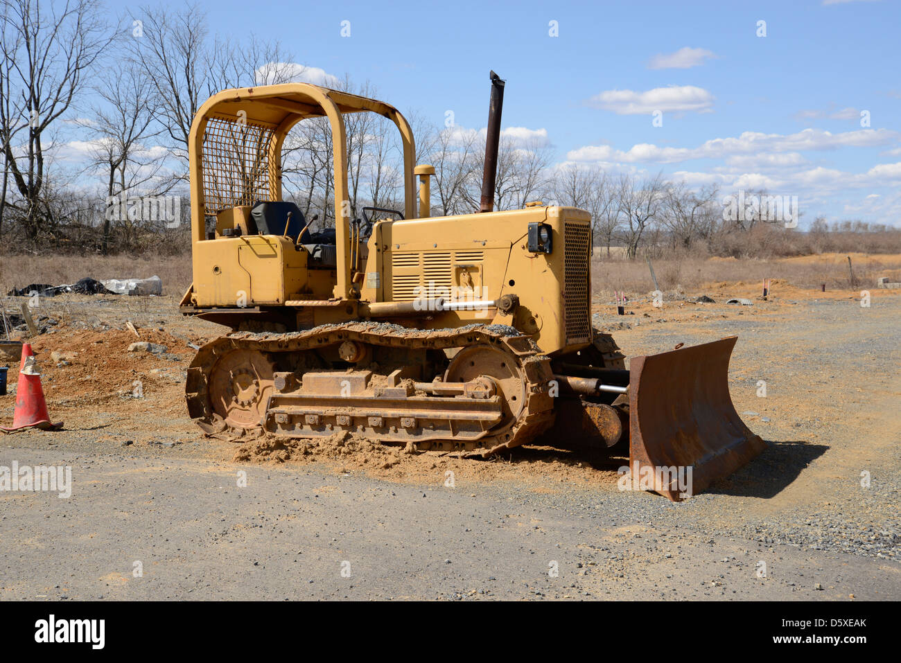 bulldozer at a construction site. A type of heavy duty equipment used in excavation. - Stock Image