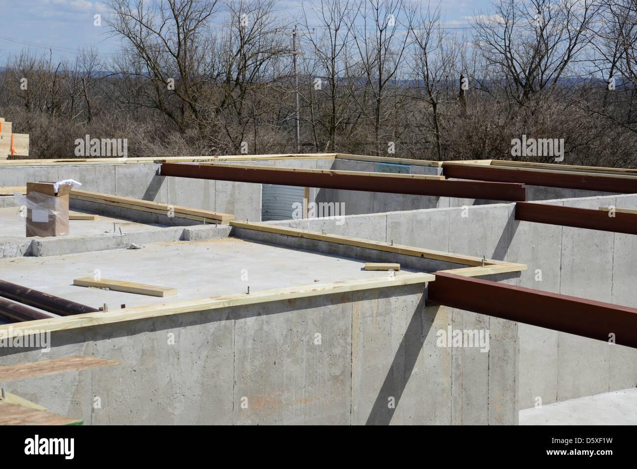 Concrete foundation with steel beams for the floor joist - Stock Image