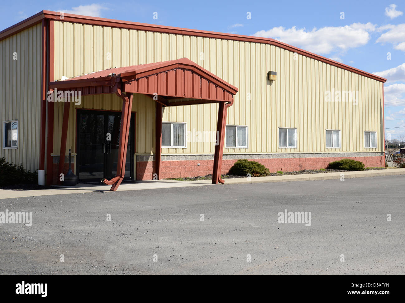 Exterior Of A Vinyl Sided Small Office Or Industrial Building   Stock Image