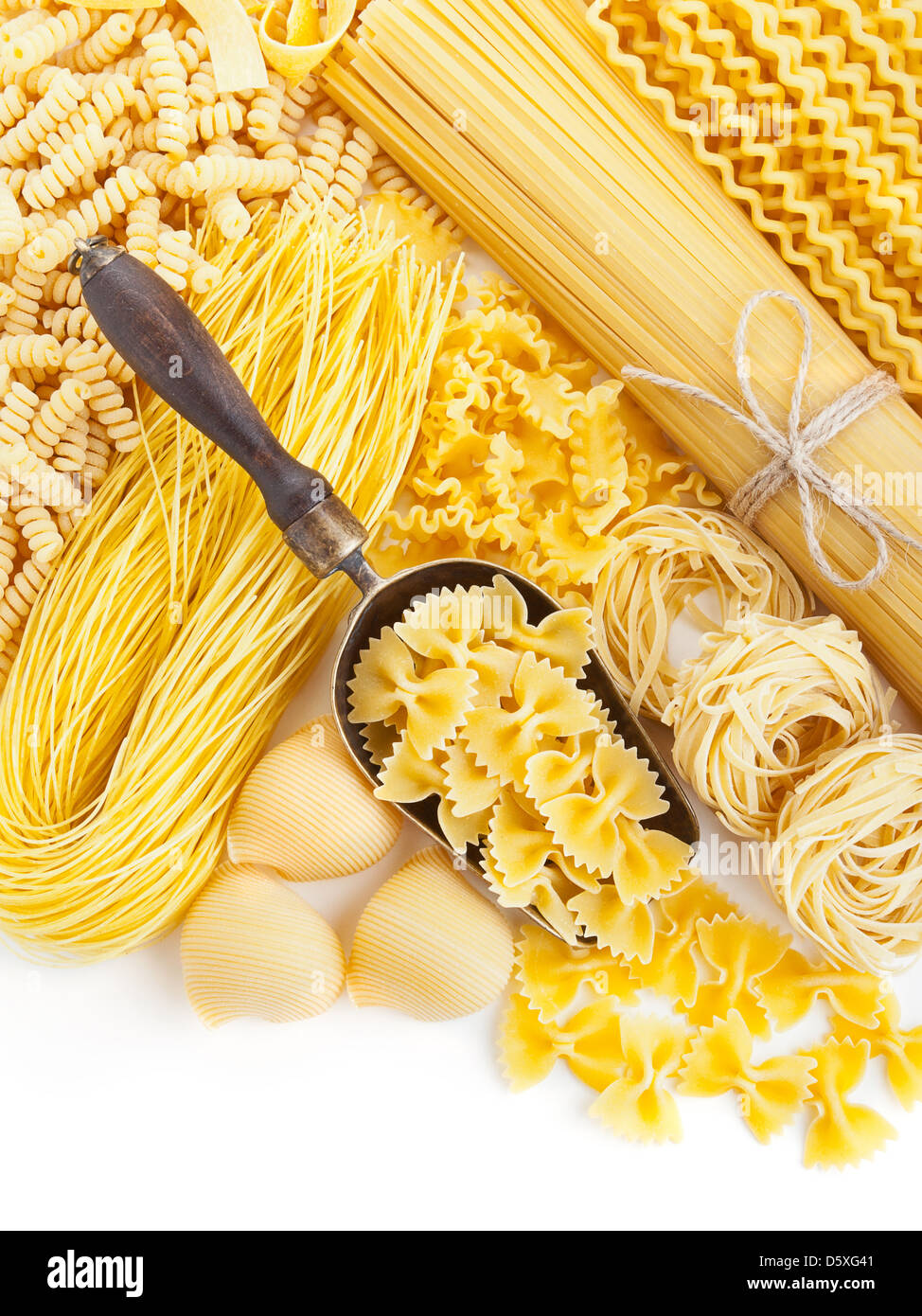 assortment of uncooked pasta on white background - Stock Image