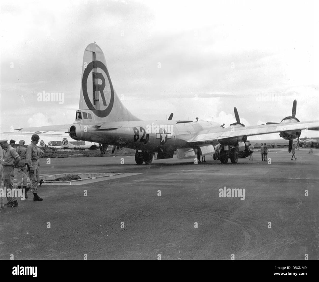 """The U.S.A.A.F. Martin-Omaha B-29-45-MO """"Superfortress"""" """"Enola Gay"""" is backed over a loading pit to upload the """"Atomic Stock Photo"""