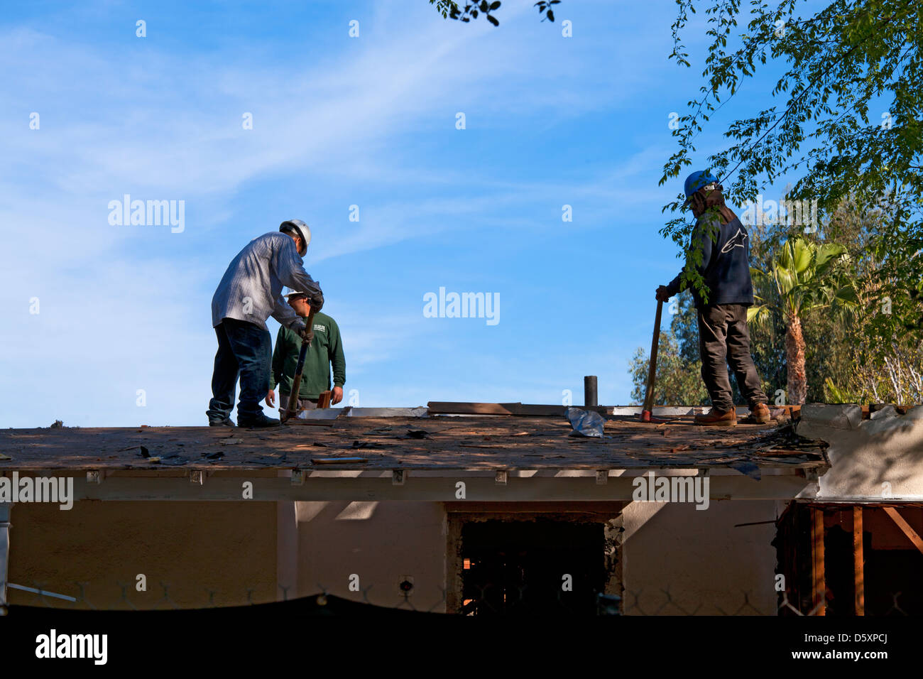Demolition of roof on single family home. Los Angeles, California, USA - Stock Image