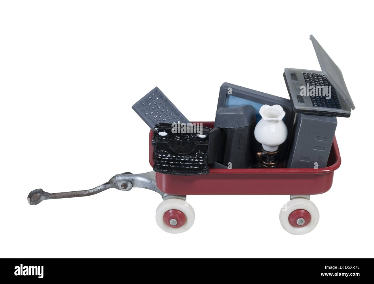 Little red wagon full of old pieces of technology - path included - Stock Image