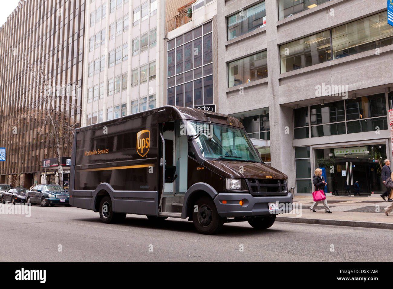 UPS delivery van in front of office building - Stock Image