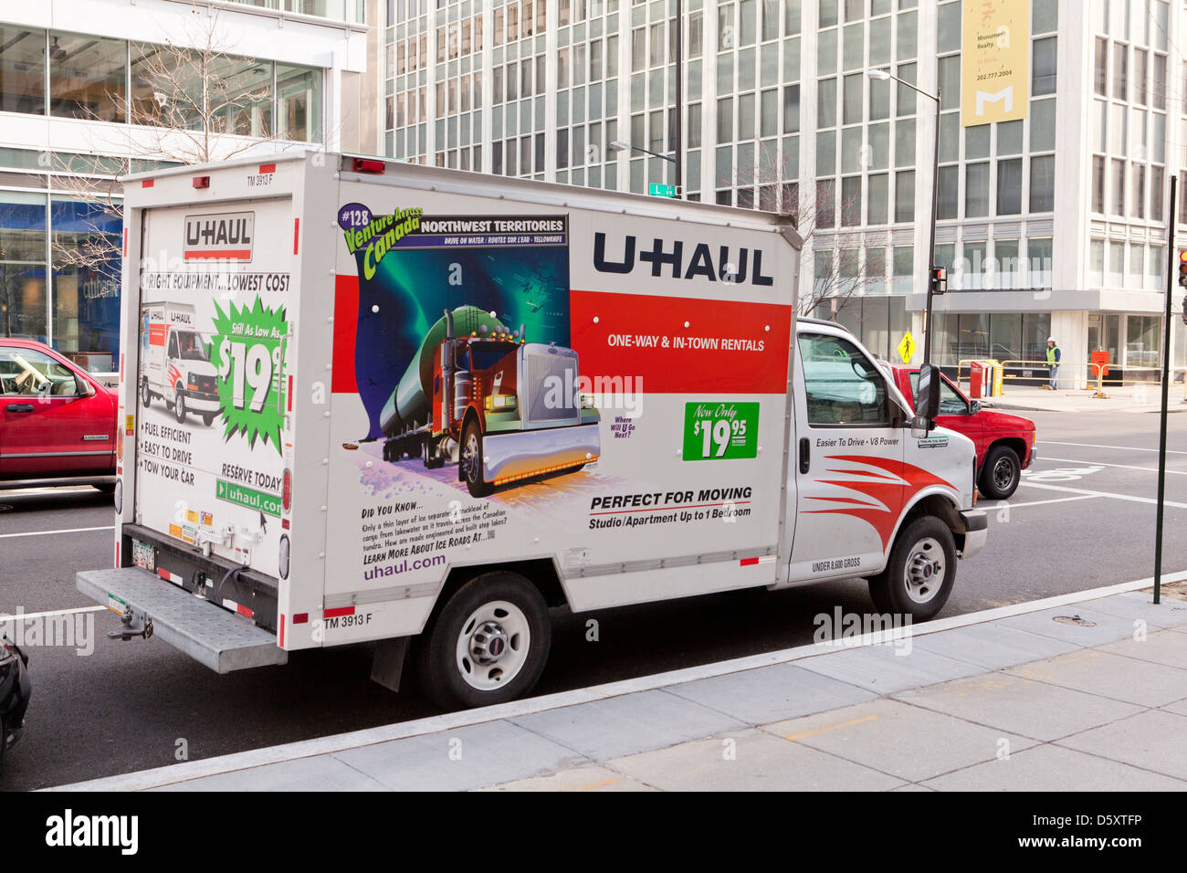 U-Haul truck in urban street - USA - Stock Image