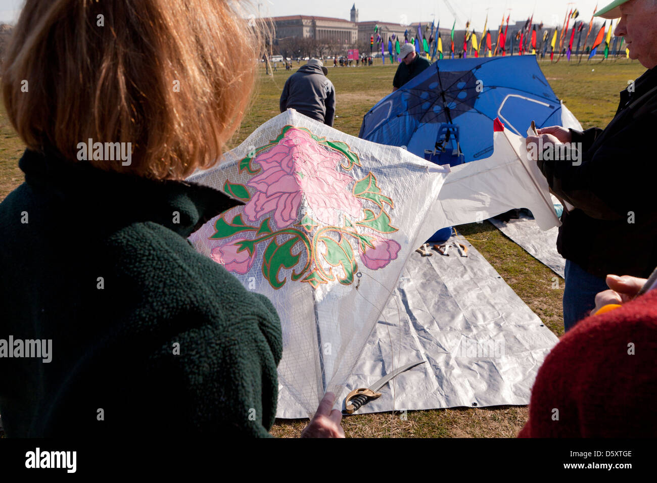 Woman holding a kite at festival - Stock Image