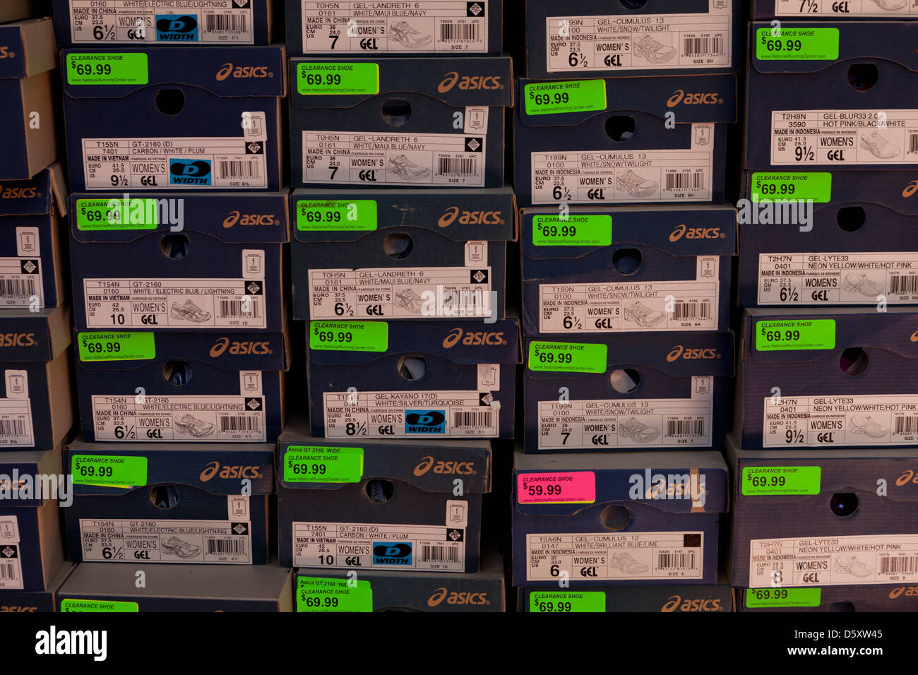 Stacked shoe boxes - Stock Image