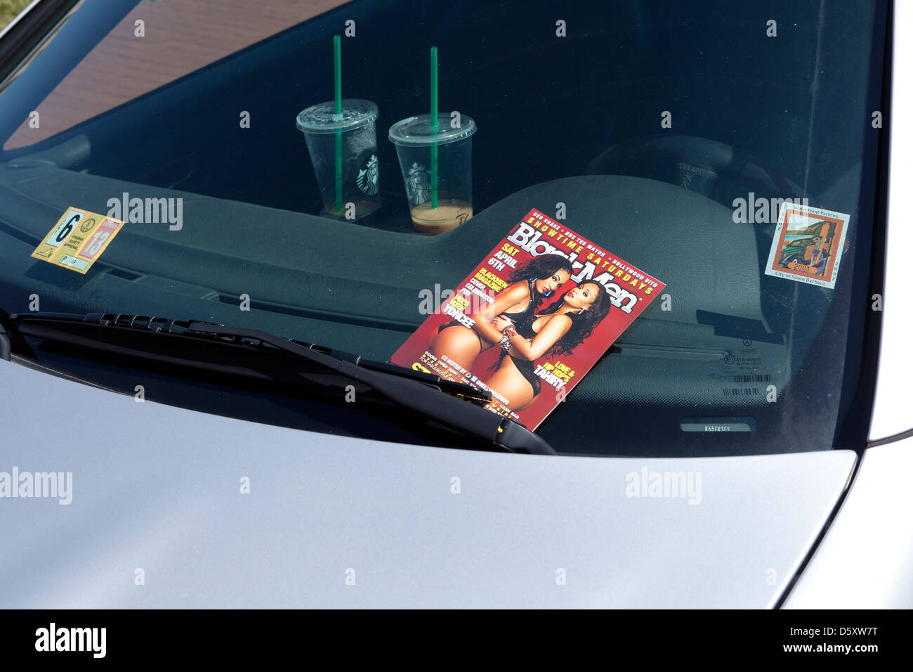 Adult entertainment ad on car windshield - Stock Image