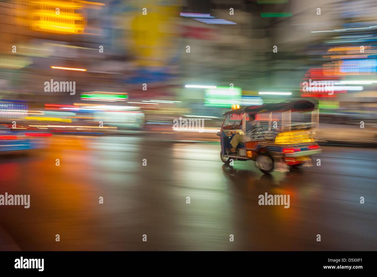 Tuk-tuk in motion blur, Bangkok, Thailand - Stock Image