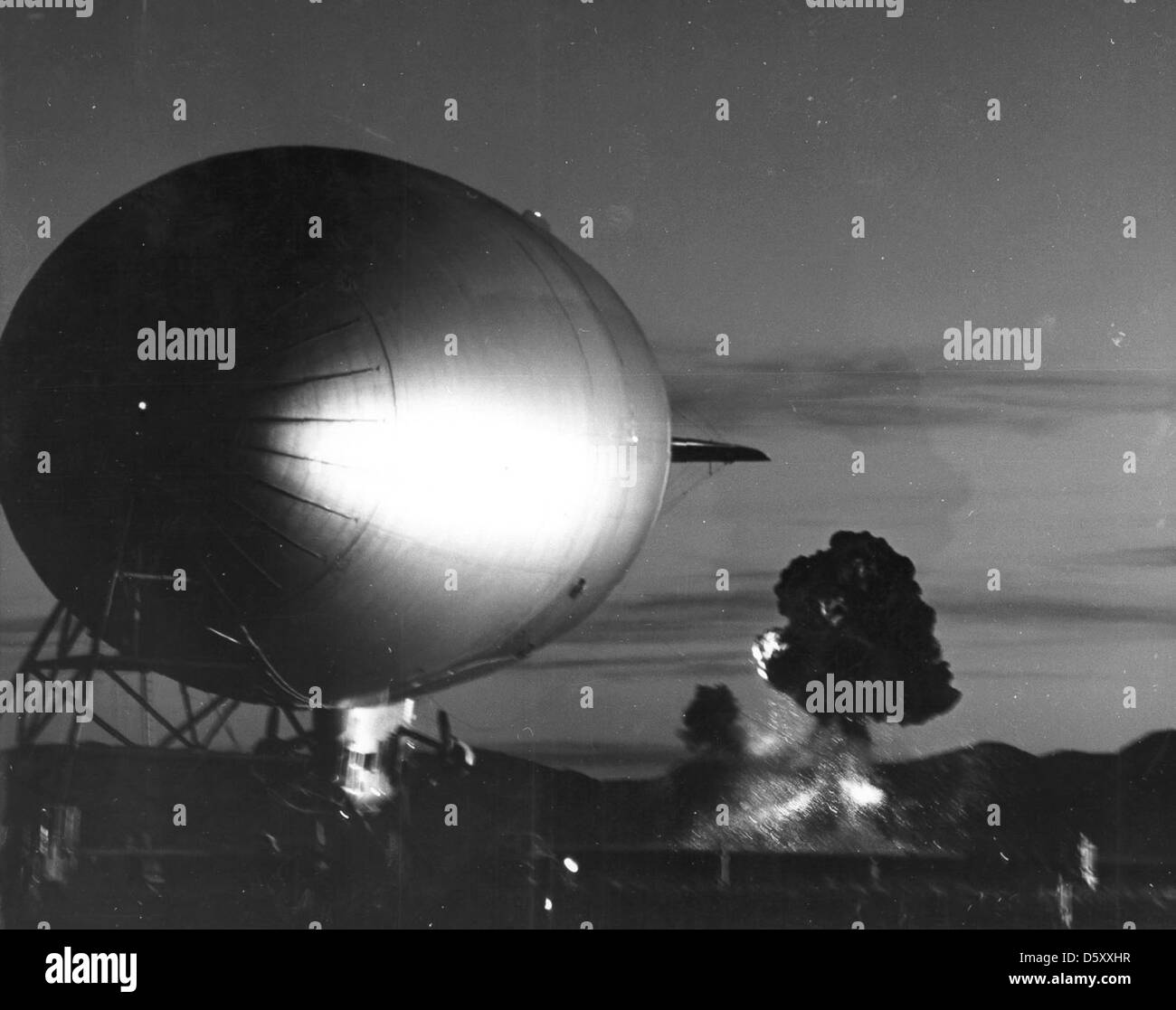 June 2, 1957 - 'SHOT FRANKLIN' fireball begins to fade as first rays of early light and flare illuminate - Stock Image