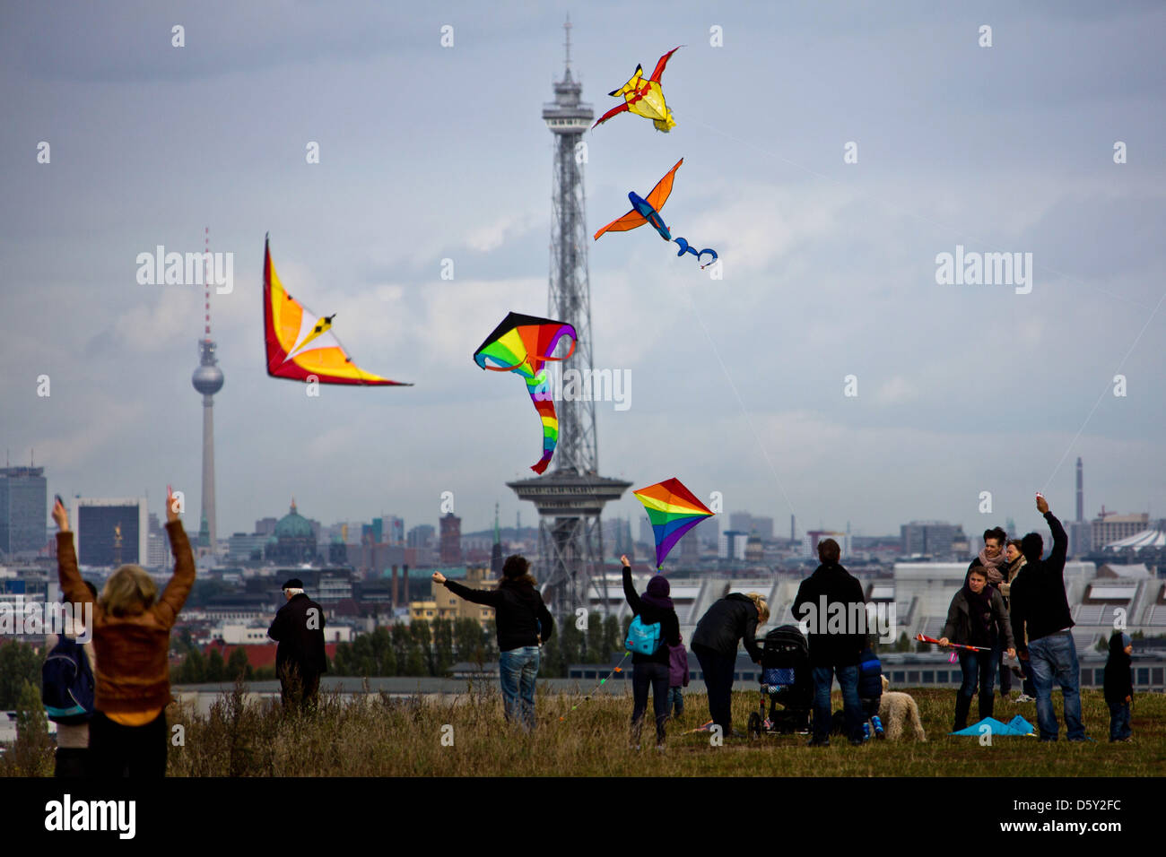 Numerous people let their kites fly on Teufelsberg (lit. Devil's Mountain) in Berlin, Germany, 07October 2012. Stock Photo