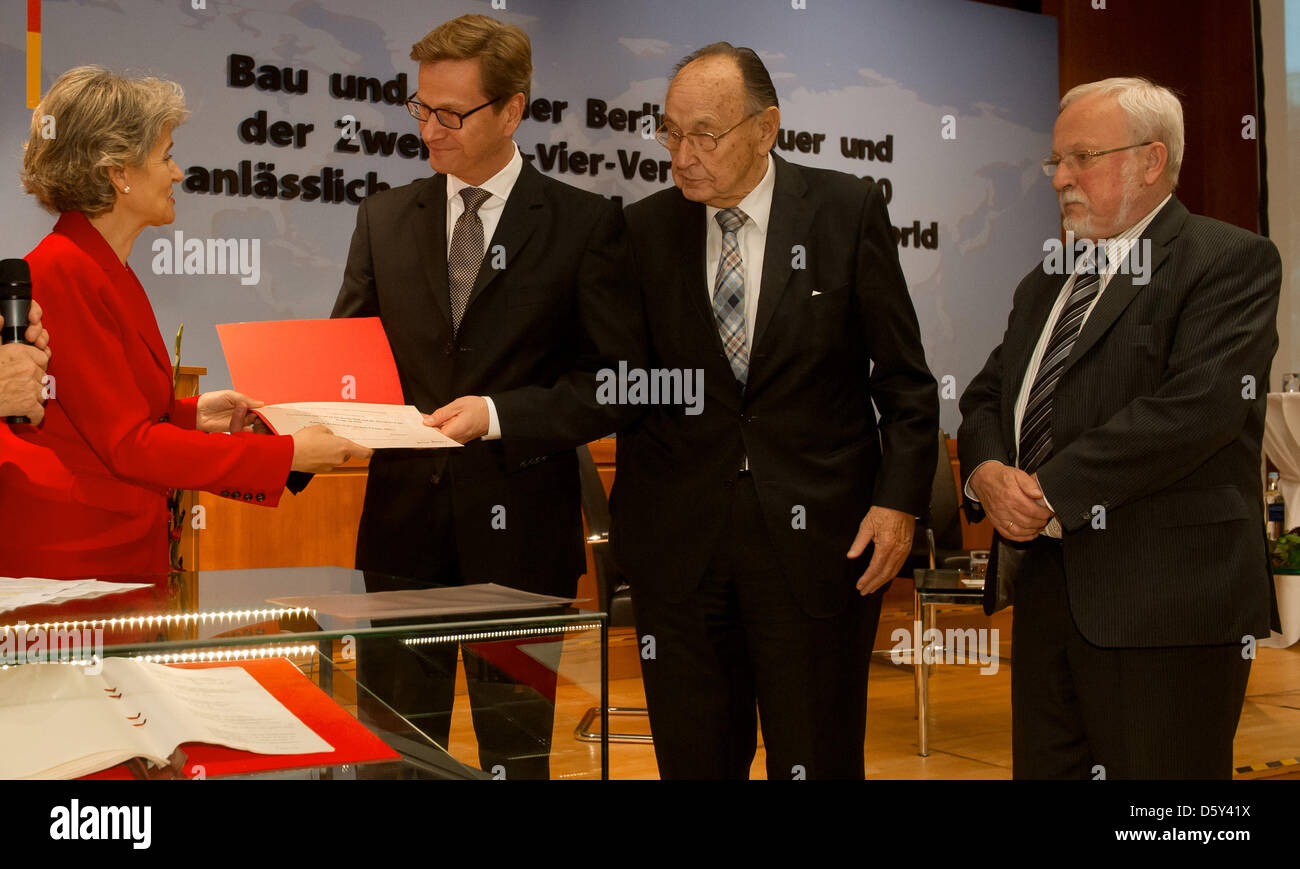 Irina Bukova (L), Director-General of UNESCO hands German Foreign Minister Guido Westerwelle a UNESCOcertificate - Stock Image