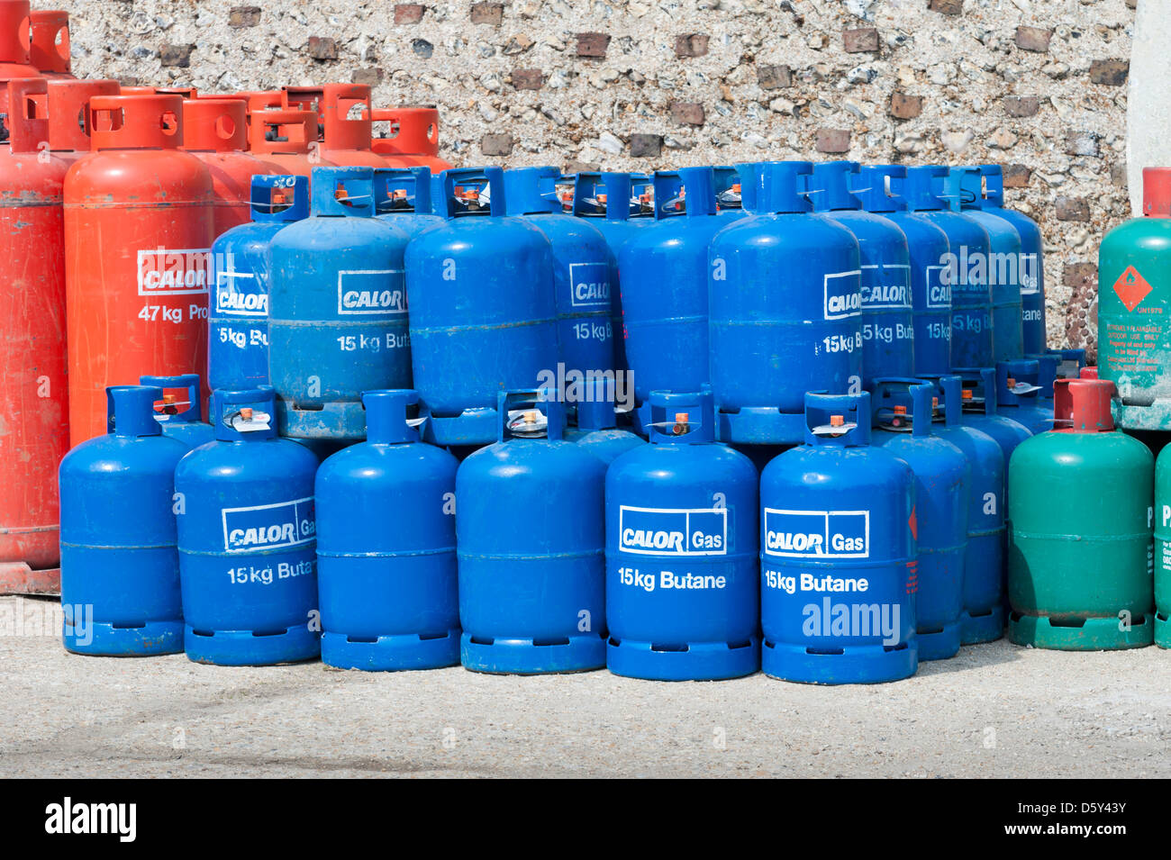 Stacks of red green and blue Calor Gas butane and Propane cylinders - Stock Image