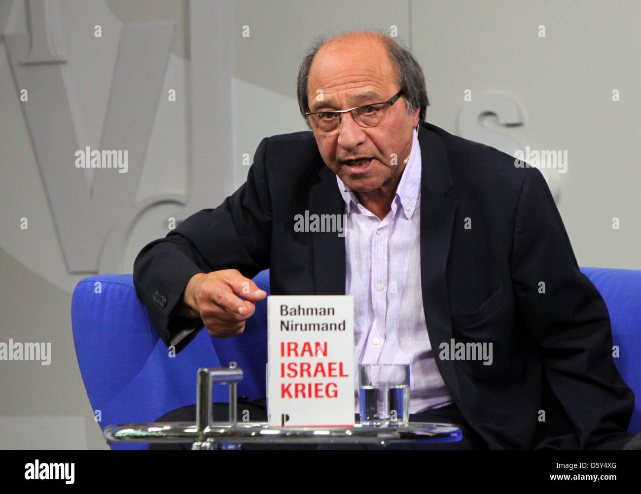 Iranian writer and publicist Bahman Nirumand presents his new book 'Iran Israel Krieg' (lit. Iran Israel - Stock Image