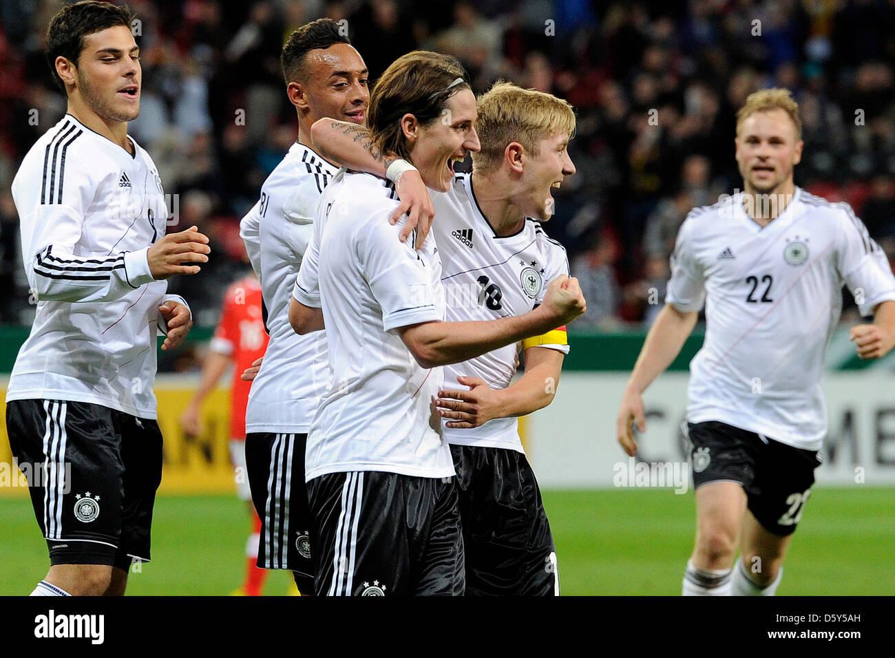 Germany's Kevin Volland (L-R), Karim Bellarabi, goal scorer Sebastian Rudy, Lewis Holtby and Maximilian Beister - Stock Image