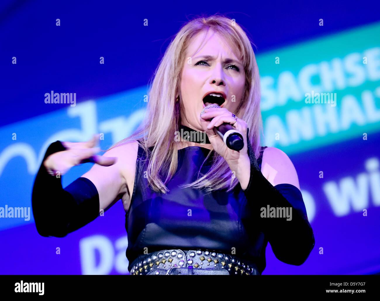 Folk singer Nicole peforms on stage at the folk music parade of the radio station MDR Saxony-Anhalt at GETEC Arena - Stock Image