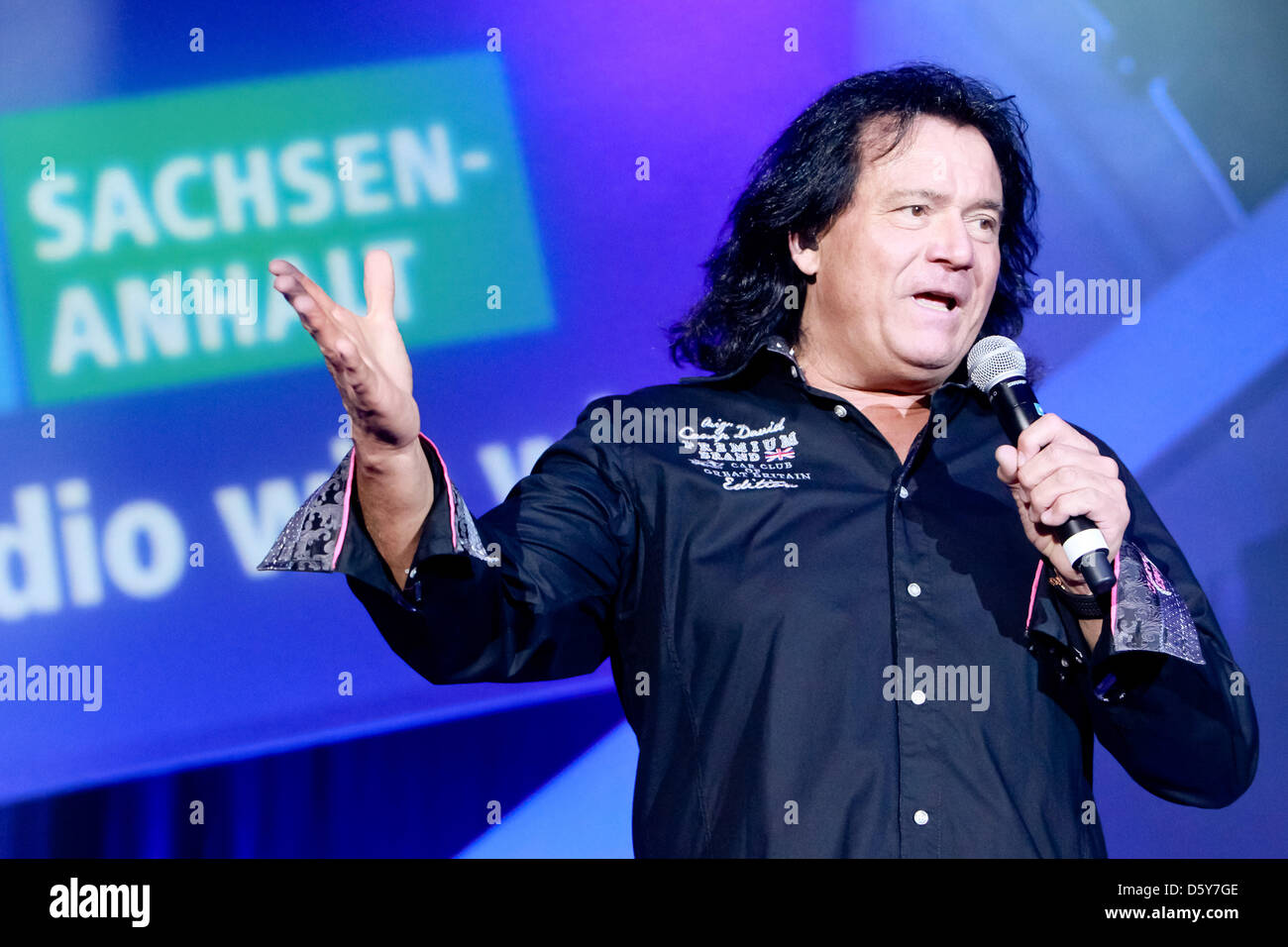 Singer Andreas Martin peforms on stage at the folk music parade of the radio station MDR Saxony-Anhalt at GETEC - Stock Image
