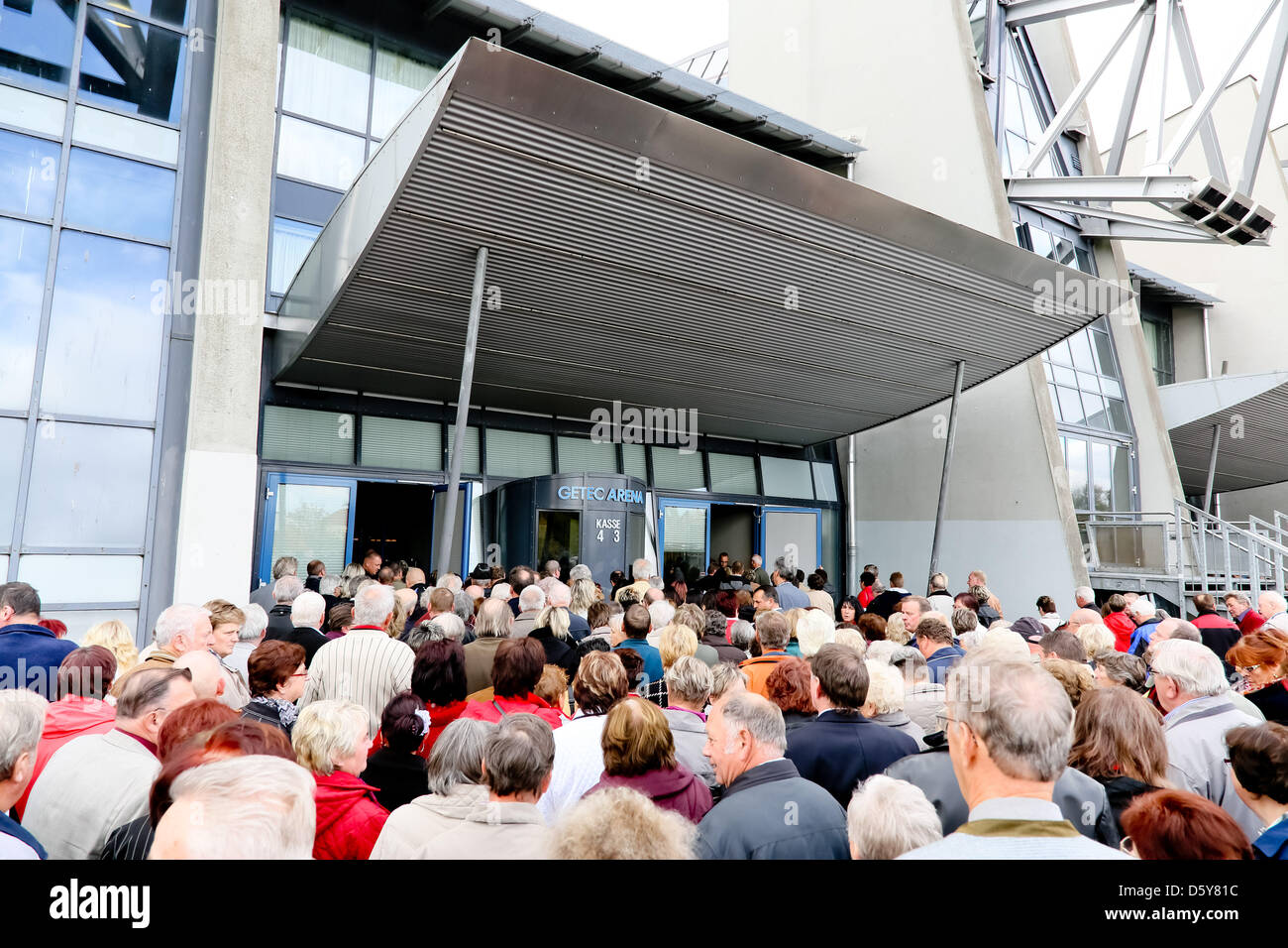 People queue for the folk music parade of the radio station MDR Saxony-Anhalt at GETEC Arena in Magdeburg, Germany, - Stock Image