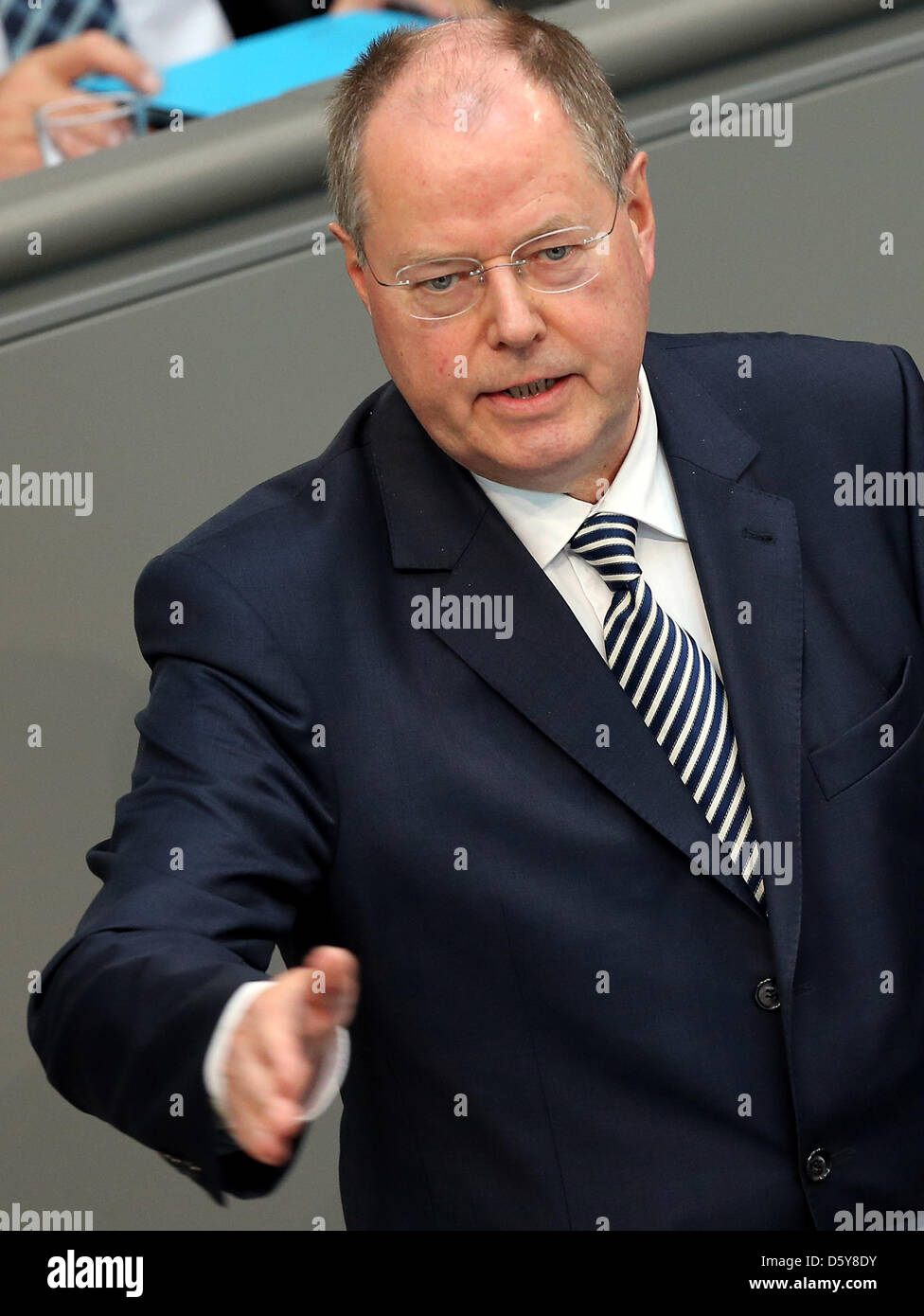 SPD chancellor candidate Peer Steinbrueck reacts to a government statement of German Chancellor Angela Merkel with - Stock Image