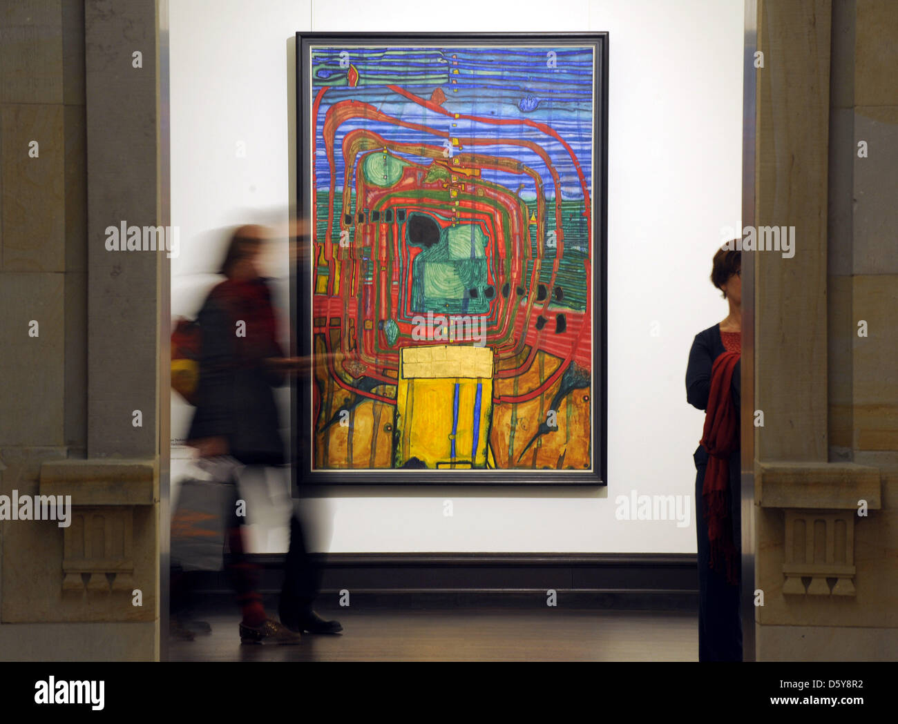 Visitors walk through the new special exhibition 'Friedensreich Hundertwasser: Against the Grain. Works 1949 - Stock Image