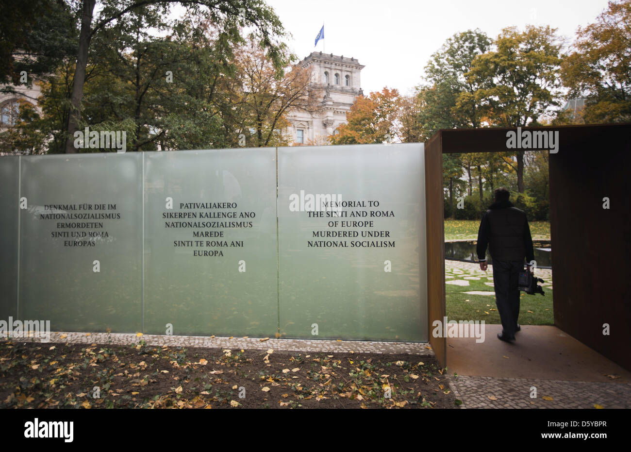 A man enters the memorial site for the Sinti and Roma killed during National Socialism in Berin, Germany, 22 October - Stock Image