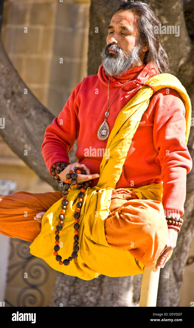 Indian male street performer balancing act Seville Andalusia Spain Europe - Stock Image