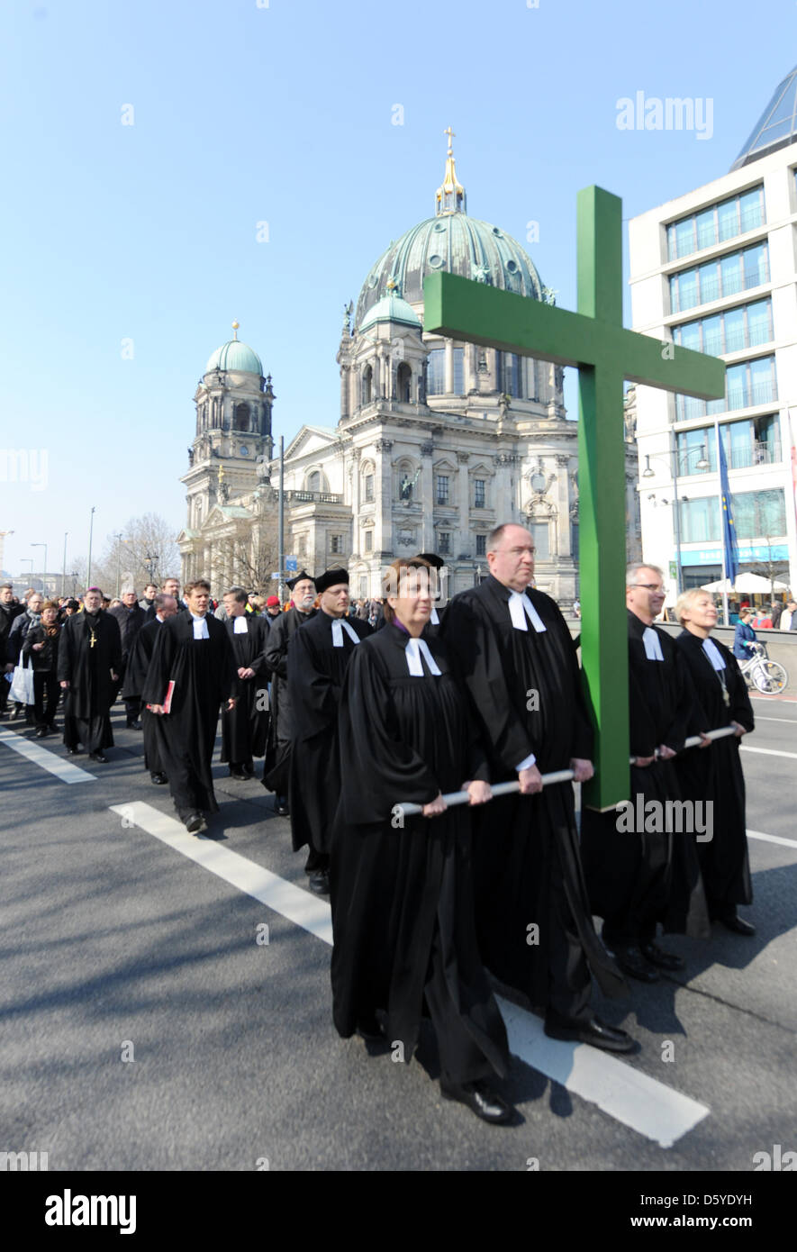 People attend the Good Friday Procession in Berlin, Germany, 06 April 2012. Numerous Christians gathered to attend - Stock Image