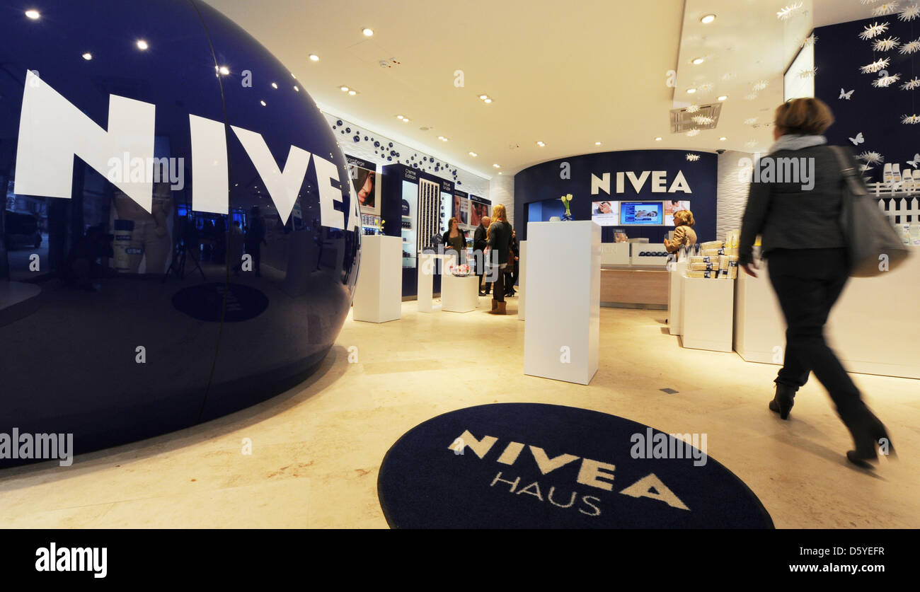A woman walks through commercial premises of the Nivea House in Hamburg, Germany, 14 March 2012. The shop of the - Stock Image
