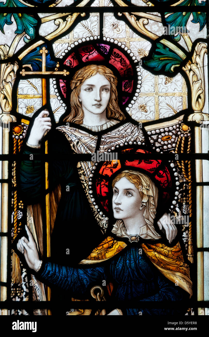 Detail of a stained glass window showing Faith, Hope & Charity in St Peter's church, Stornoway. - Stock Image