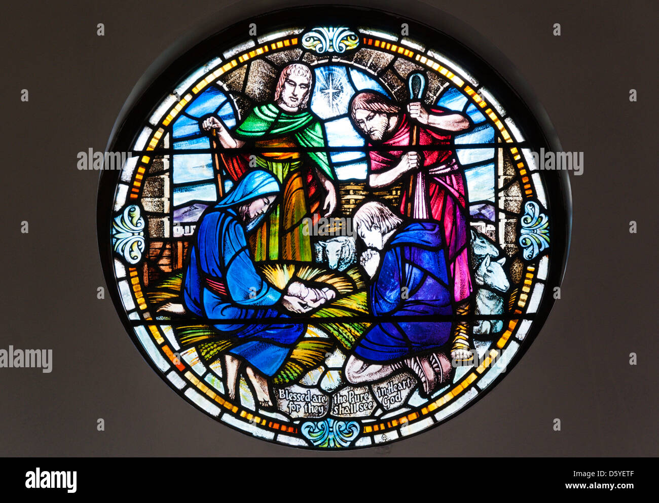 Chancel window showing the Adoration of the Shepherds in St Peter's church, Stornoway. - Stock Image
