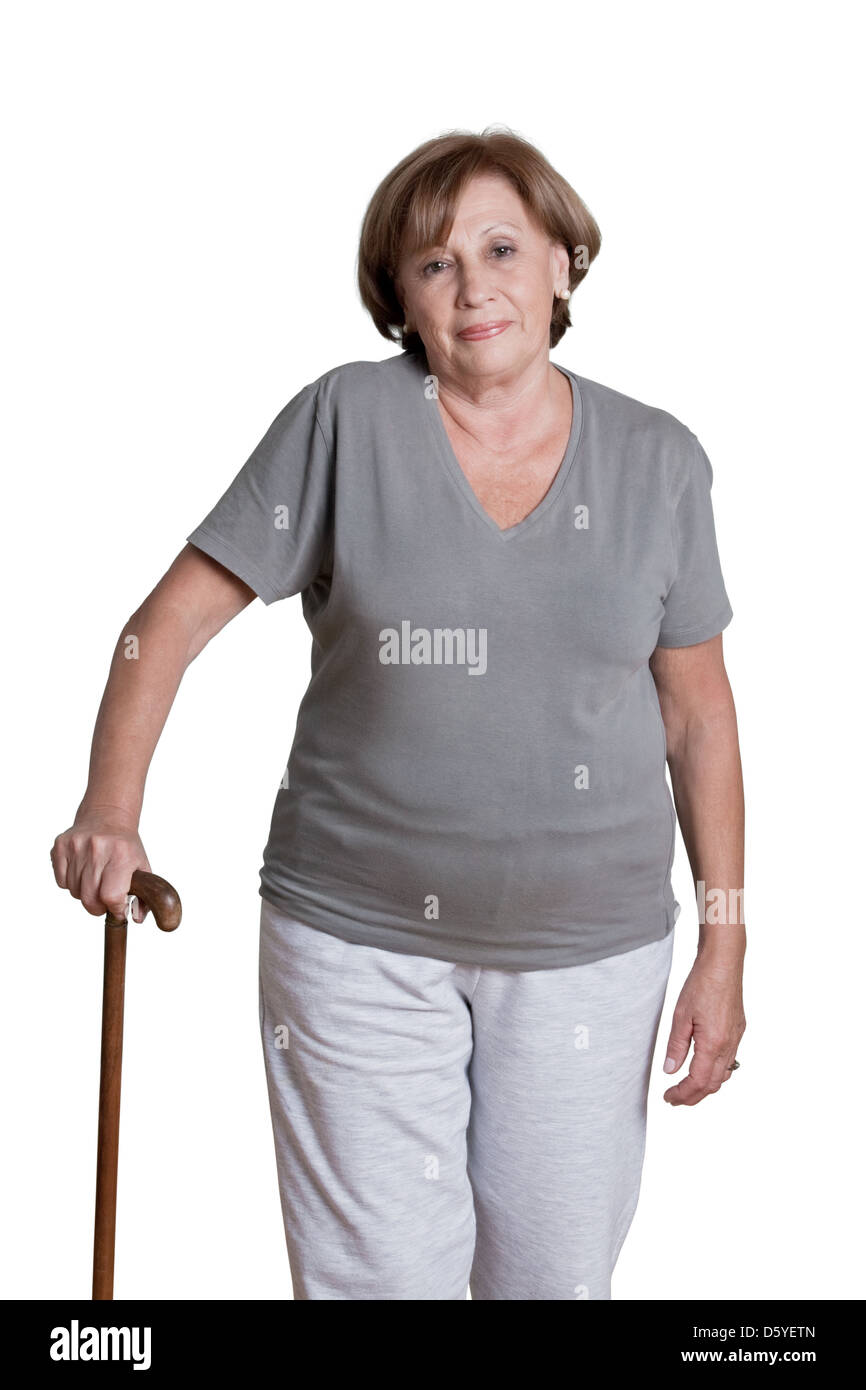 Mature Woman with Walking Stick - Stock Image