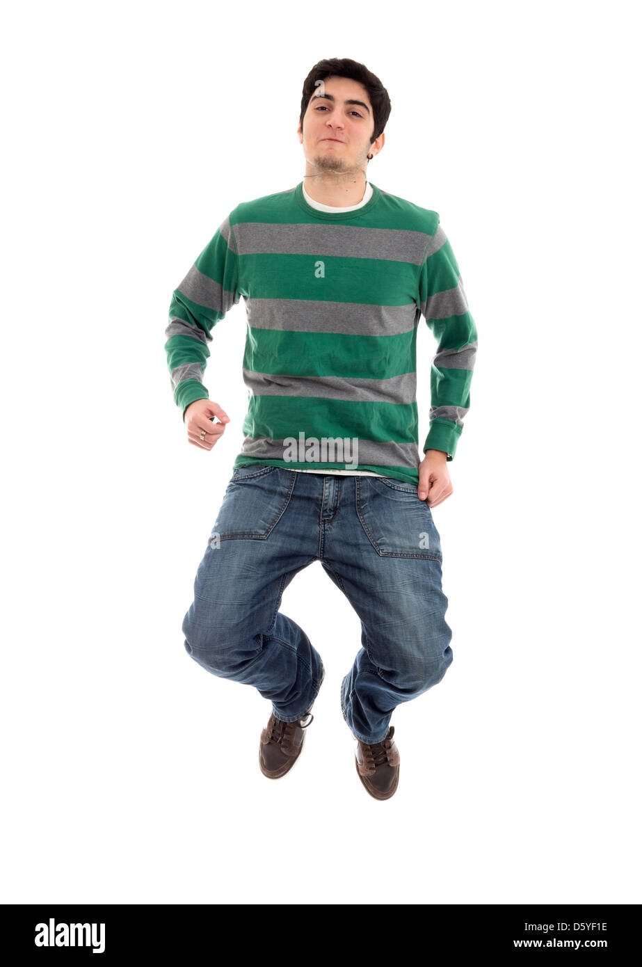 Cut out of man jumping isolated on white background - Stock Image