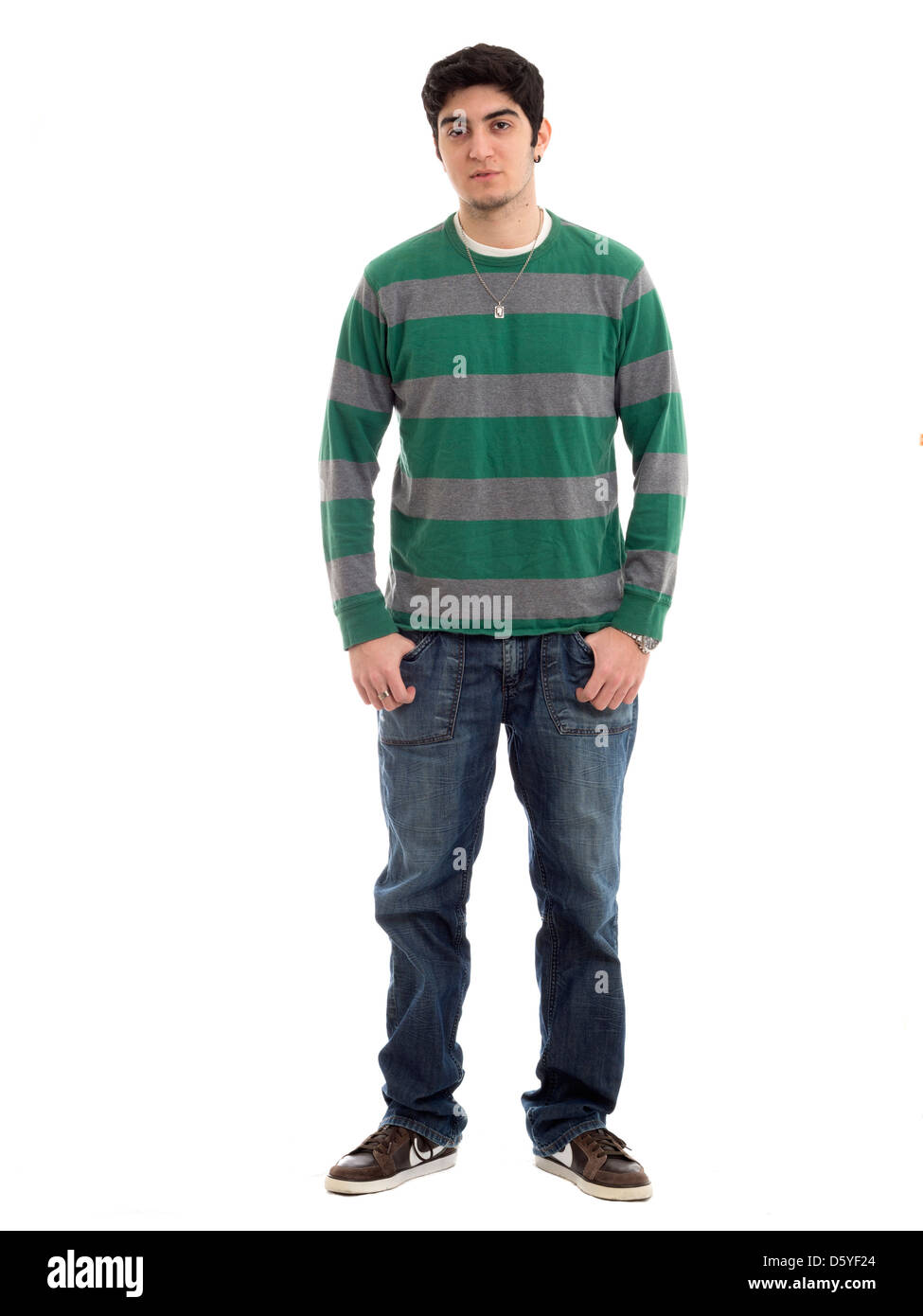 Full length portrait of young man with hands in pockets isolated on white background - Stock Image
