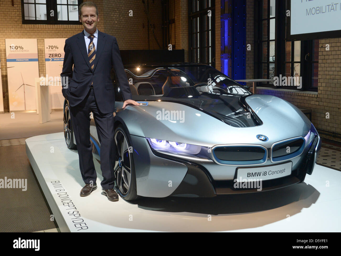Development Director Herbert Diess Stands Next To A Bmw I8 Concept