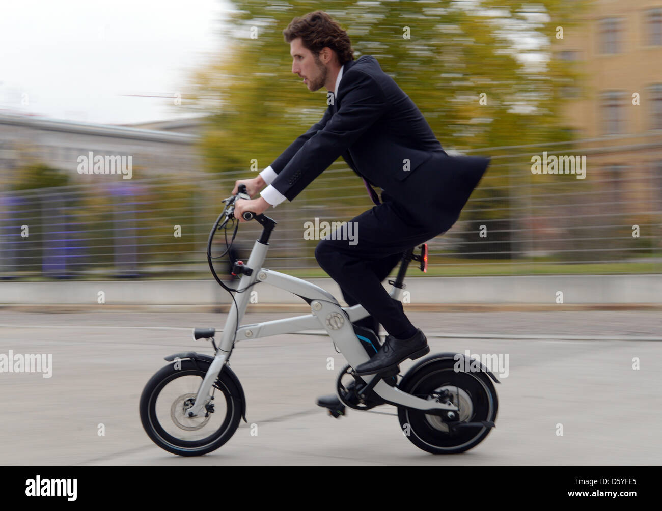 b4b59501ee3 A man rides a BMW I pedelec concept foldable bicycle at E-Werk in Berlin,  Germany, 23 October 2012. The strategic concentration of the BWM group on  the ...