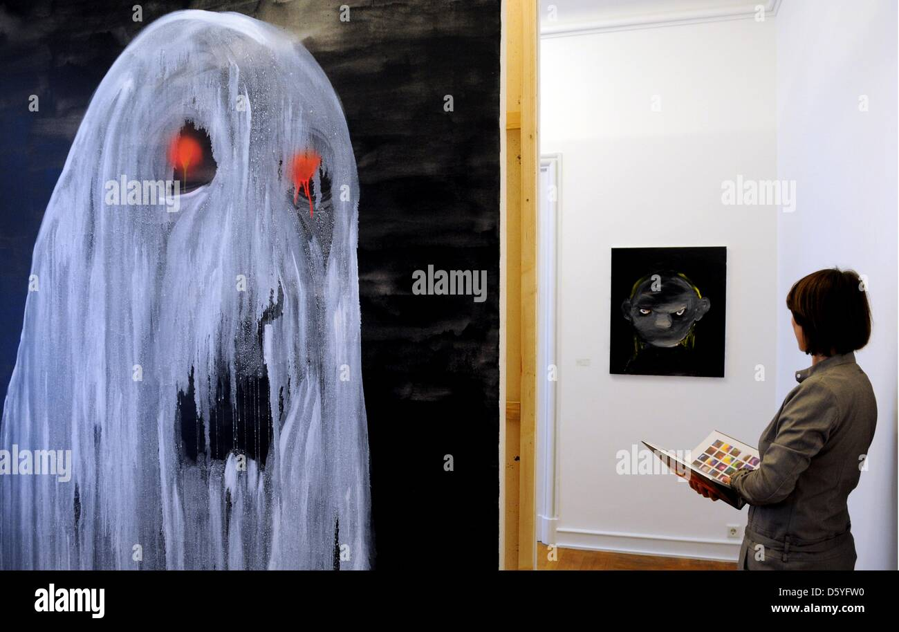 A visitor views the works Untitled (2010) by Heike Kati Barath at the exhibition 'Zeit Gespenster - supernatural - Stock Image