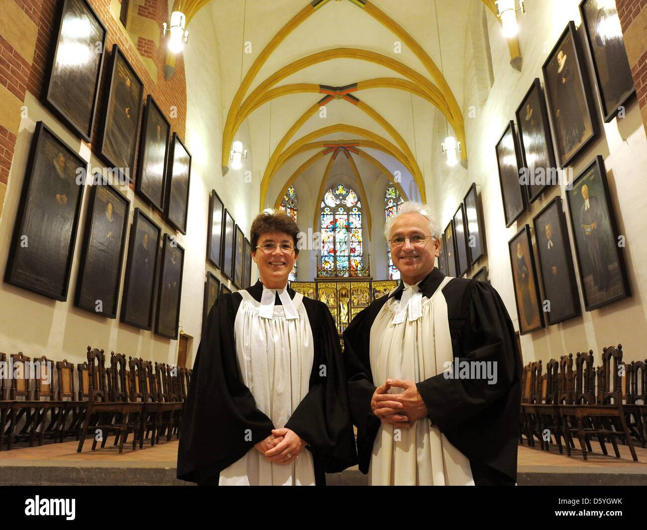 The two pastors Christian Wolf and Britta Taddiken are pictured after a church service held at the St. Thomas Church - Stock Image