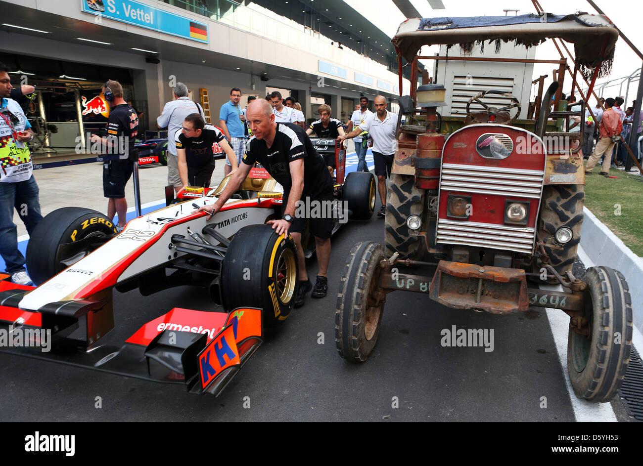 Mechanics Push Back The Racing Car Of Spanish Formula One Driver