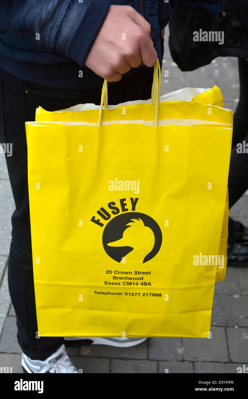 Shopping bag for the Fusey mens fashion store run by the only way is Essex cast member Joey Essex - Stock Image