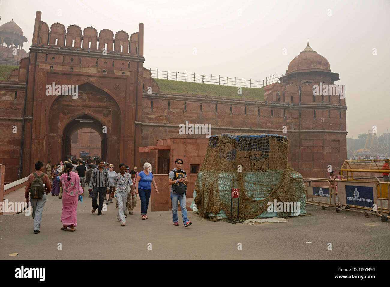 Visitors enter the Lahore Gate to the Red Fort in Old Delhi, India - Stock Image