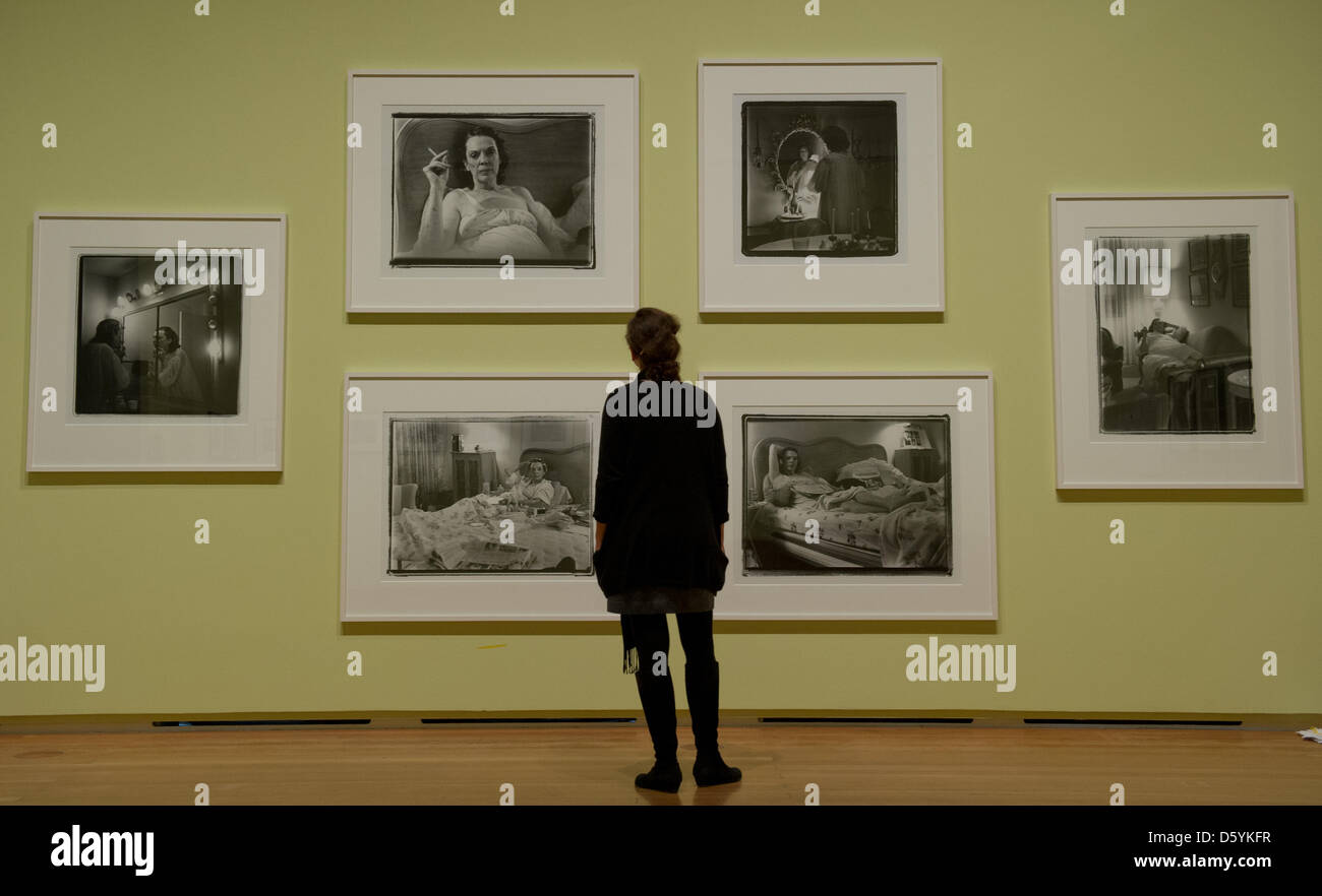 A woman stands in front of Marylin Minter's works portraying her addict mother at the 'Privat' ('Private') - Stock Image