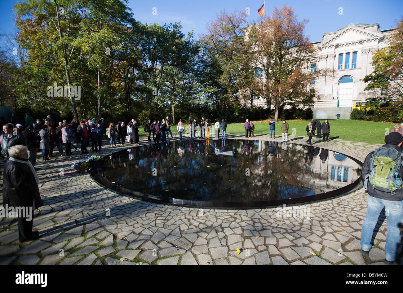 Visitors are pictured at the newly opened memorial for Sinti and Roma who were murdered by the Nazis at the Tiergarten Stock Photo