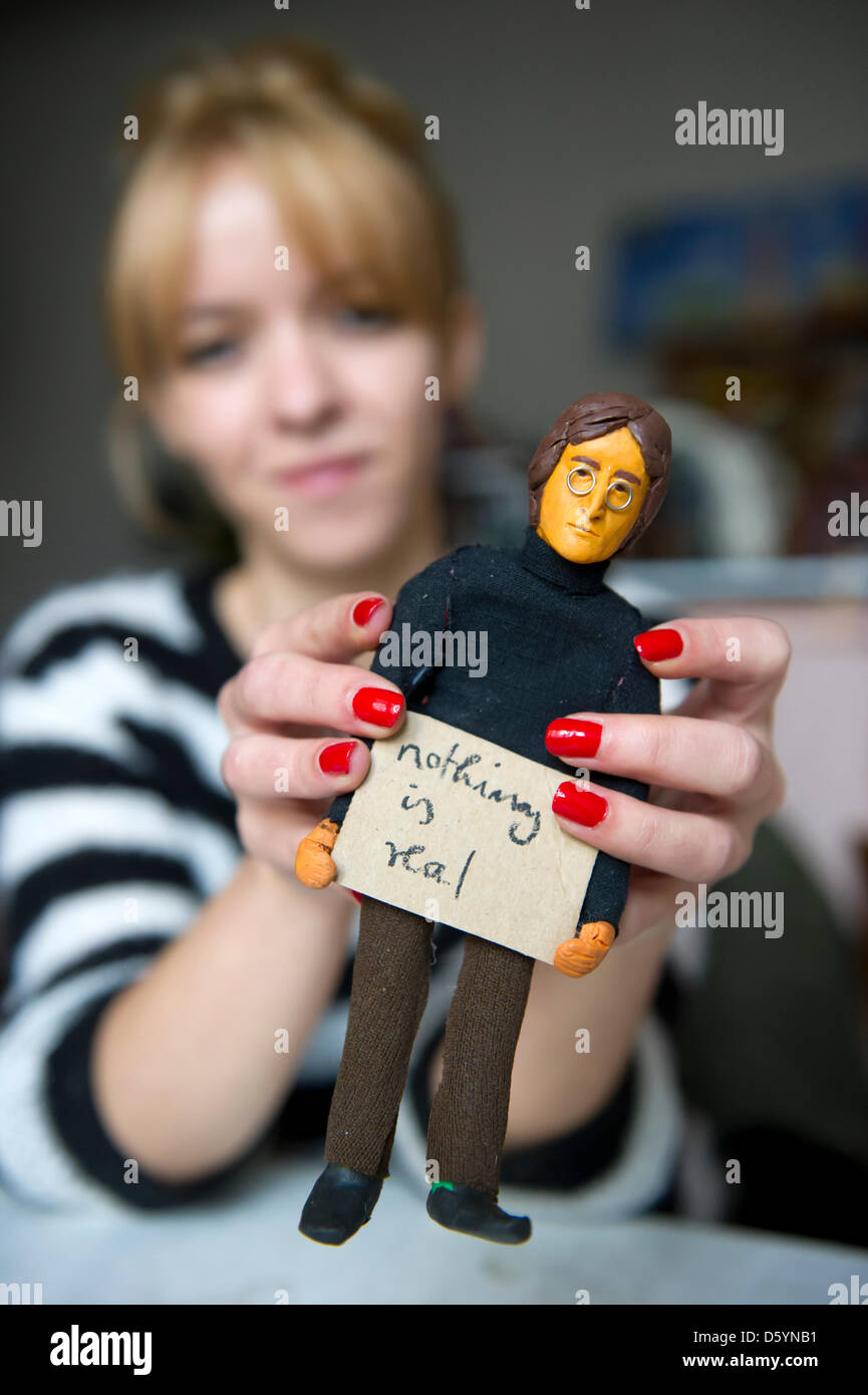 Linda Jakobson holds a clay figures singer John Lennon in Berlin, Germany, 26 October 2012. Berlin artist Linda - Stock Image